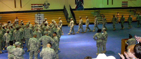 The troops file into the gym for welcome ceremonies.